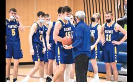 Minneota senior Jacob Hennen is given the game ball by head coach Dave Busselman after scoring his 1,000th career point on Saturday night.