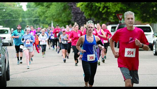 Runners take off in the 5K Bug Run race.