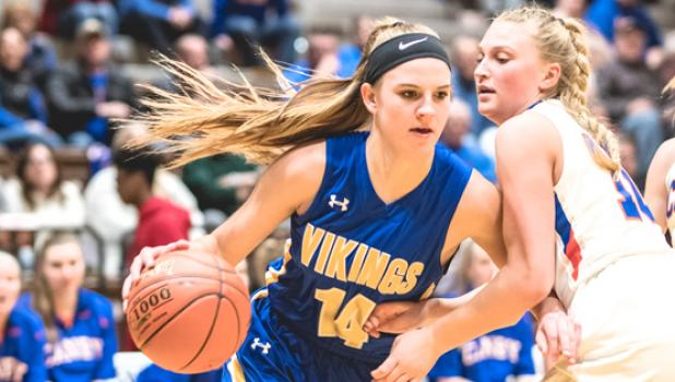 Abby Hennen drives to the basket for two of her game high 31 points.