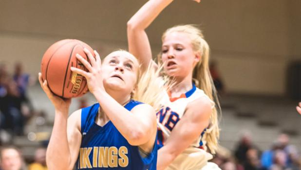Abby Rost is fouled from behind as she attempts to convert a shot in the lane.