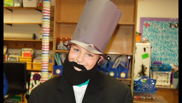 Landon Tolk as Abraham Lincoln.