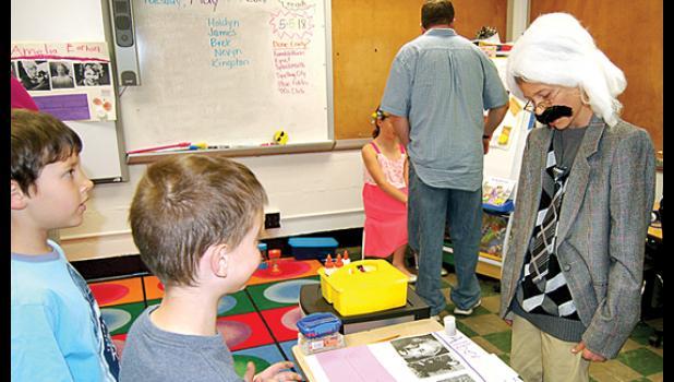 Landon Esping portrayed Albert Einstein as other kids watched.