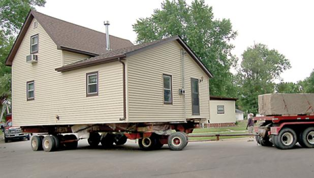 Thein Moving Co. of Clara City has done this many times and negotiating a corner was no problem.