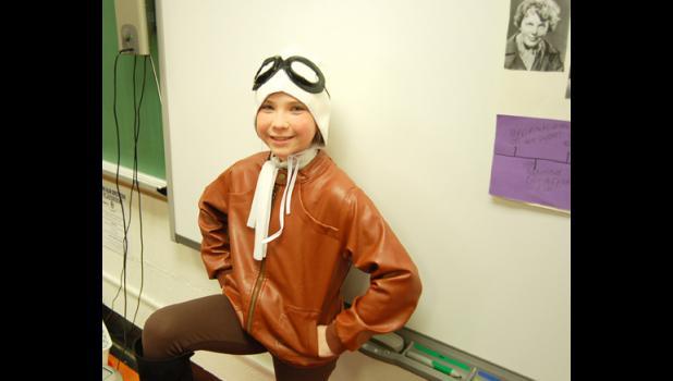 Ava Panka as Amelia Earhart.