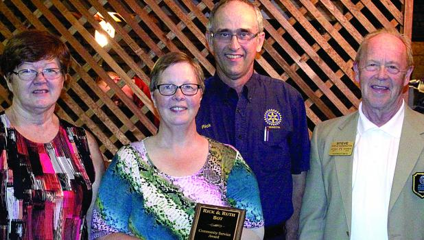 Ruth and Rick Bot got their award and were surrounded by Minneota Rotary President Cindy Potz (left) and District Governor Steve Harrington, right.