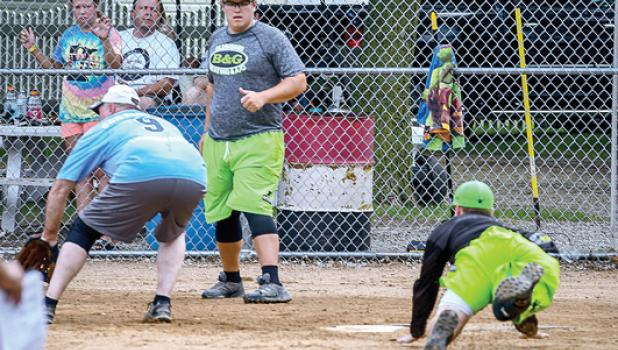 B&G Plumbing and Heating scores on a close play at home against Bend Rite Fabrication in the Belgian American softball Tournament in Ghent last weekend.