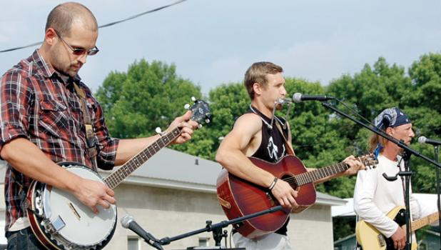The Broken Oak, featuring from left Jesse Breems, Jake Moravetz and Mark Colvin, performed on Saturday during the Summer Bash