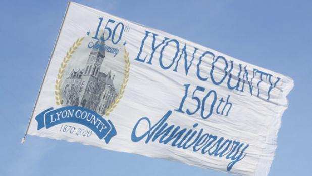 A closeup of the 80-foot commemorative banner as it flies over the Marshall Airport on Saturday.
