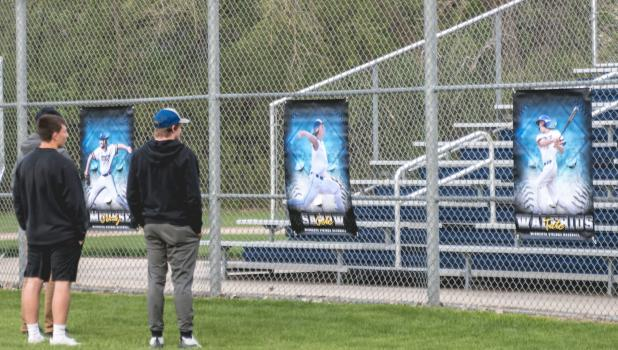 Minneota Viking senior baseball players Cole Sanow, Tate Walrius and Grady Moorse look over the banners at the baseball ball field that they were presented with  last week.