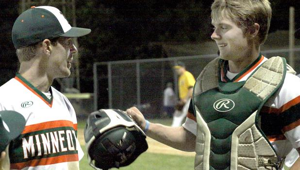 After earning a save on the mound, Beau Buysse (left) was congratulated by catcher Austin DeVlaeminck.