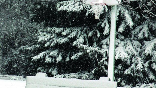 While he coated the city park on Madison Street with a nice snow cover, creating a winter scene on the basketball court, he wasn't nice to drivers.
