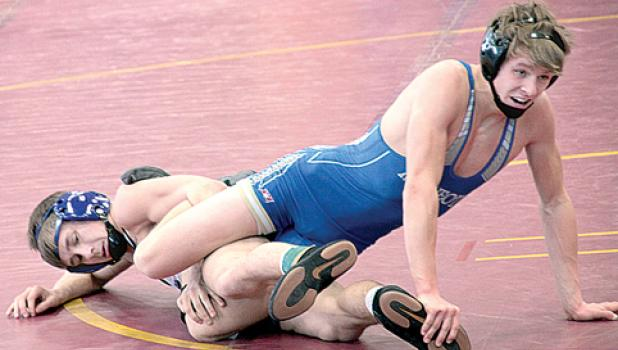 Minneota's Brant Buysse at 126 pounds and Z-M's Mike Vath seemed to be all tangled up. Vath won, 4-2.