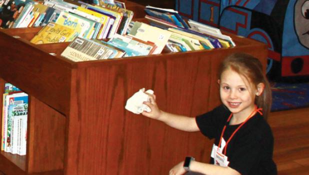 Brisbyn Traen and five other students were found dusting at the Minneota Public Library.