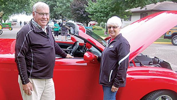 Dale and Nancy Buysse of Minneota stand in front of Nancy's 2003 Chevy SSR pickup truck during the Car Show.