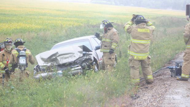 Several members of the Minneota Fire Department, as well as First Responders and the Lyon County Sheriff's Department responded to a smashed vehicle in the ditch on the west side of County Road 3 just outside of Minneota in the rain on Monday.