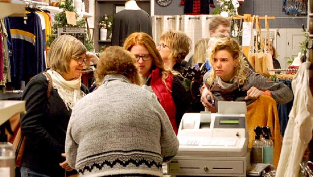 Shoppers gathered around the till at the Arched Door.
