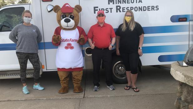Laura Swedzinski, co-director for Minneota First Responders,  the good neighbor bear, Christian Becker  and Emily Coequyt, the other co-director for Minneota First Responders