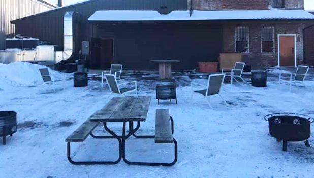 Tables and chairs and a fire pit were set outside to keep patrons warm.