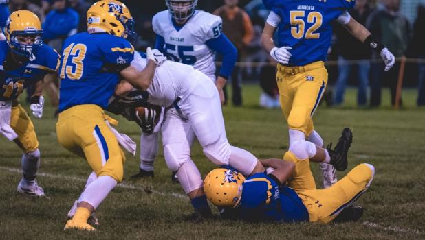 Cole Sanow heled with a tackle as a teammate held on.