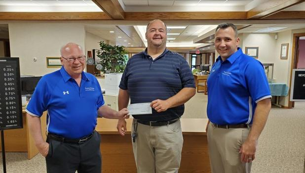 Countryside Golf Club General Manager Tony Esping, center, received a check from State Bank of Taunton President Duane Peterson, left, and Vice President Doug DeSmet to sponsor this year's Countryside Fun Day golf event.