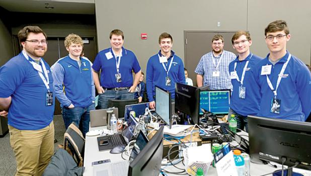 DSU's CyberForce Competition team placed fourth in the nation. Team members are: Austin Fritzemeier, Micah Flack, Kyle Korman, Chris Loutsch, advisor Cody Welu, Peter Engels, and Hunter DeMeyer.