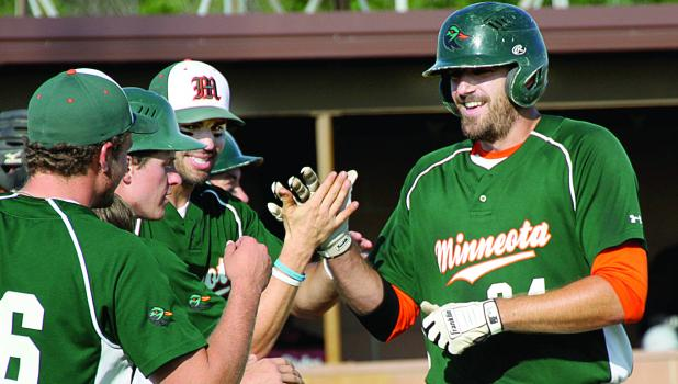 Danny Hennen (right) got congratulations from teammates after his home run gave them a 2-1 lead.