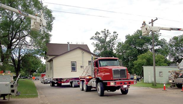 It was moving day Wednesday for the old Bud Bernardy house. The school bought the property and sold the house to Mel Breyfogle for $1. He moved it to a new location. OtterTail helped move the wires.