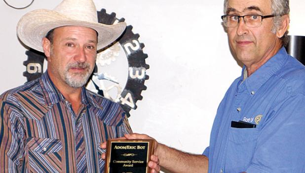 Eric Bot (left) was presented the annual Community Service Award by current Minneota Rotary President Rick Bot. The event was held at the City Hall Bar and Grill last Thursday in Minneota.