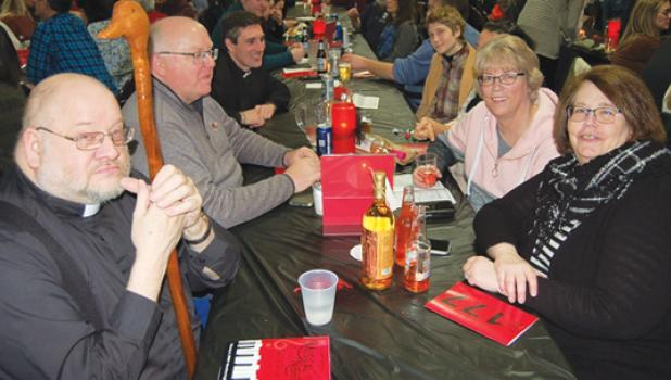 """Everyone was having a great time at """"Musical Night Out"""", including this group from St. Edward School (above). Left to right, Father Keith, Mike Horner, Father Craig, Claren Novotny, Sondra Hohlford (hidden), Robin Traen and Mary Ann Horner."""