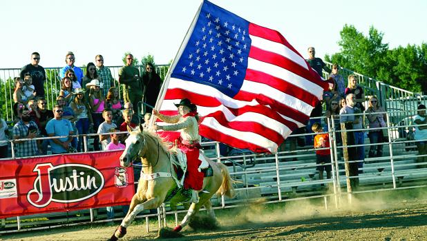 Flag rider at the PRCA Rodeo at the Lyon County Fair.