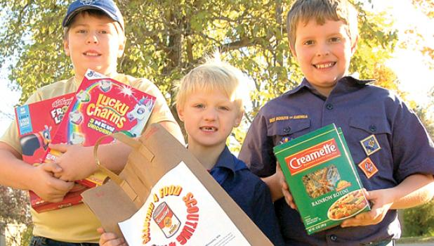 Three Minneota Cub Scouts from Pack 30 collected non-perishable food items Saturday from community members for the annual Scouts 4 Food drive to combat hunger in the United States. Pictured from left to right are Jents Knutson, Max Laleman and Connor Boerboom.