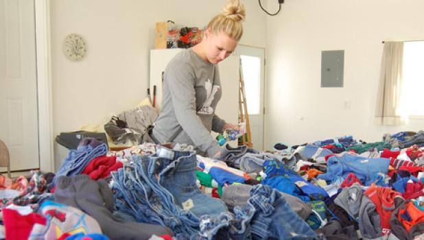Katie Boettger took advantage of the mild weather this past weekend to take in one of the places participating in the the 10th annual citywide garage sale sponsored by the Mascot.
