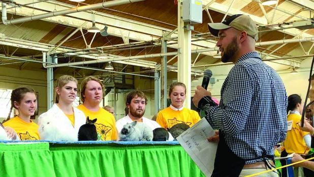 """Gared Moorse and """"Nugget"""" listened to Judge Zach Sauer (fourth from left), then came up big in the judging."""