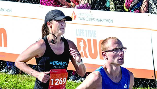 Lisa Gillund running in the Twin Cities Marathon.