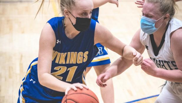 Abby Rost drives around an RTR defender on the way to the basket on Saturday night in Minneota. Rost scored nine points and grabbed 11 rebounds for Minneota.
