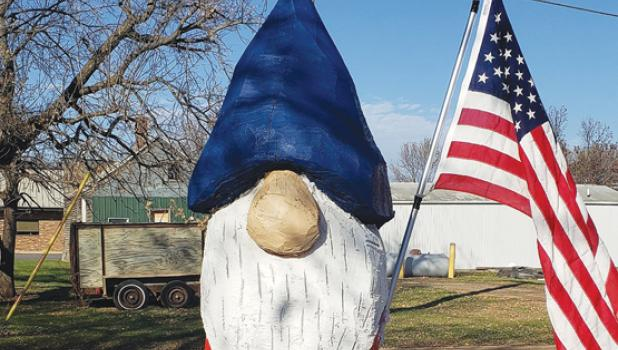 This gnome, which was shown unpainted in the Mascot several weeks ago, was recently painted and affixed with a flag for Veterans Day. The gnome was cut with a chainsaw from an old tree on the Phil and Margie Breyfogle home in Taunton by their son-in-law, Lee Jacobs. Phil Breyfogle, an Army veteran who recently turned 98, passed away last Friday evening.