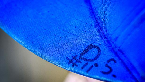 """Grady Moorse wears """"D.S. #11"""" on his baseball hat to keep his friend's memory close to him."""