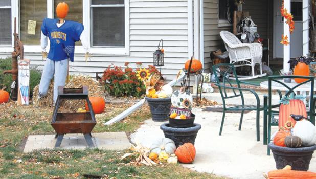 Carey and Pete Doycher have their home decorated for fall and Halloween with several pumpkins, gourds, a bat, and even a stuffed Minneota football scarecrow.