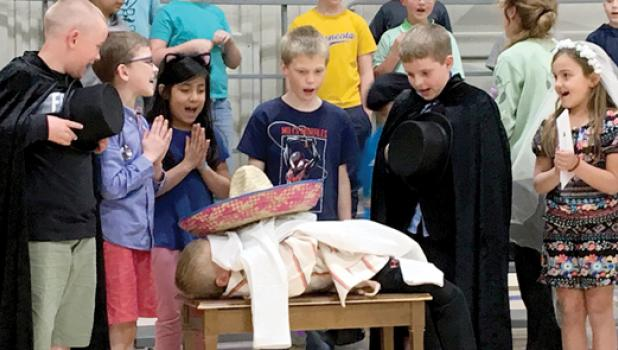 During the Second Grade's Mexican Folk Song, Derek Fier waved to the crowd. He would pass away with his mourners gleefully watching over him.