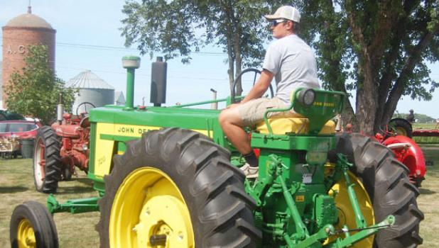 Zach Hennen prepares to ride his restored tractor in the Tractor Parade on Saturday afternoon in Porter.