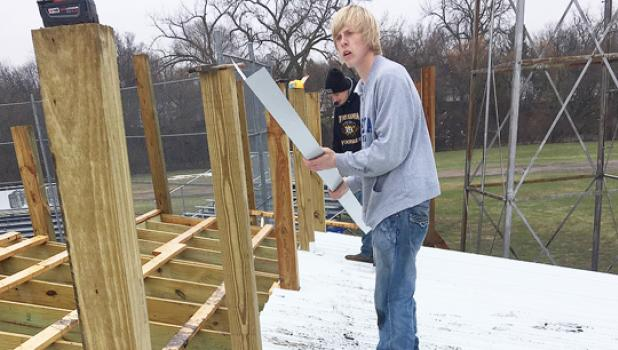 Assisting with the construction is Austin Sorensen.