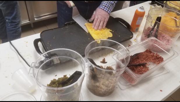 Joe Verschelde whips up an omelette.