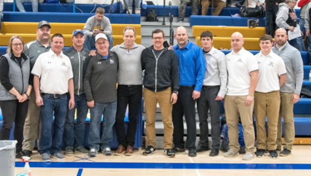 Joel Skillings (center) was recognized by the Wrestling Boosters on Tuesday night for his years of service and dedication to the program.