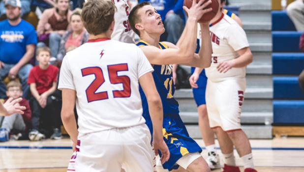 Joey Rybinski went up for a shot while being defended by Saints.