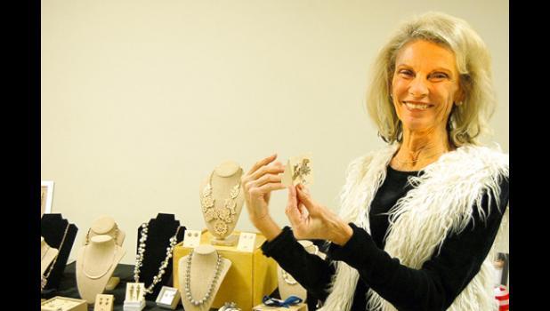 Showing off jewelry she liked was Darlene Josephson.