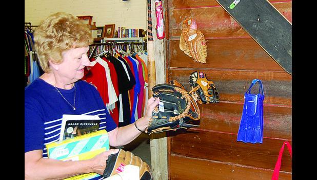 Volunteers like Kathy Wyffels help sort through the items.