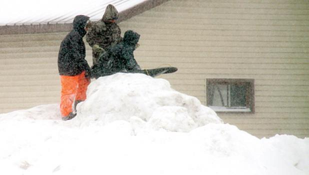 Kids all over Minneota didn't have school on Tuesday so they improvised. You find a pile of snow, grab a sled or something to slide on and THERE IT IS — a snow day filled with entertainment. These kids were on Second Street Tuesday afternoon.