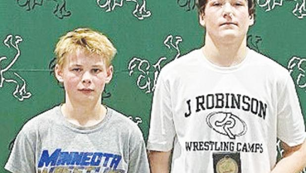 The Minneota 7th and 8th grade wrestlers who placed individually at the NWYA State Tournament, left to right: Adam DeVlaeminck, seventh place at 95 pounds, and Eli Gruenes, fourth place at 135 pounds.