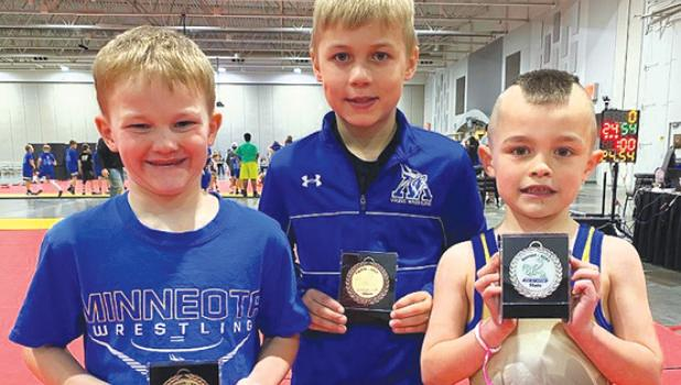 The Minneota K-6 wrestlers who placed individually at the NWYA State Tournament, left to right: Bryson Javers, seventh place at 50 pounds; Derek Fier, eighth place at 64 pounds; and Jacob Myrvik, second place at 45 pounds.