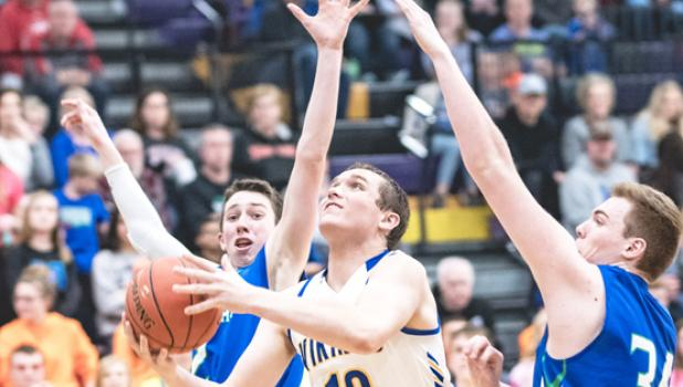 Logan Sussner splits the MACCRAY defense for two points.